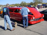 red Ford station wagon