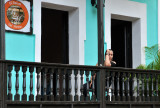 Woman looking down from restaurant's balcony
