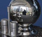 A reflection of yours truly on table-top chrome sphere!