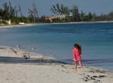Young girl running around shoreline