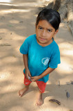 Cambodia. A serious black-eyed girl