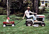 Giving Dan a ride while mowing - 1982