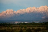 The city of Las Cruces, NM in valley beneath the Organ Mountains