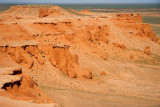 The Flaming Cliffs get their name from the red color of the exposed soil and rock