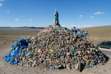 Roadside monument to local spirits.  Mongolian drivers honk as they drive by to pay their respects.