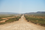 Road to Ulaanabaatar.  The main road is under construction, so cars must drive on the roads on either side.