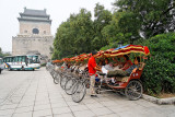 Pedicabs arrayed near the Drum and Bell Towers, ready for Hutong tours