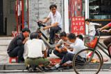 Hutong street gathering to pay a game