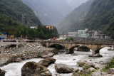 Road construction and hydroelectric power plants are a constant sight on the way to Wolong