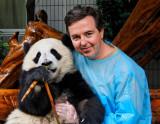 Chris with panda cub at Chengdu