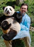 Chris with a squirming panda cub, Wolong
