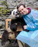 Chris with a panda cub, Wolong