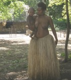 Yakel woman carrying a child