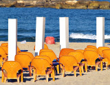 orange chairs white stacks1.jpg
