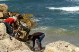men picking up bottles at the sea.JPG