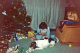 Sharon watching Thompson & Erica unwrap Xmas gifts