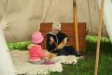 Little visitors inside mediewal tent