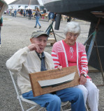 George and Wilma near the kiosk Michael Webster put up of George's life as a boat builder and racer.