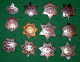 group of obsolete SF badges
