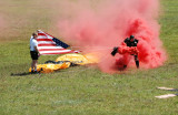 Fla .Airshow - US ARMY Golden Knight Lands with US Flag--