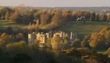 Castle ruins in arboreal splendour.