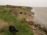 A World War 2 pillbox succumbing to the ingress of the sea.