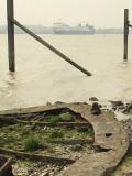 Sunken barge beside the shore.