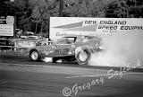Jungle camaro blows engine on burnout.jpg