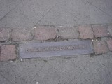 marking the former line of the wall through the city...