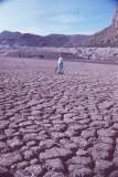 Mother walking on mudcracks