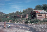 1980 - The roof on the southern part is still attached