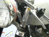 0833 Aluminuim spacer between the headlight bracket and the clip on (hides the fork tube which is not chromed)