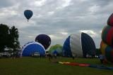 Jayhawk ballon soars while Powercat sits on ground ....