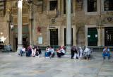 people waiting during prayer