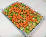 Brussel sprouts with baby carrots before baking at 350
