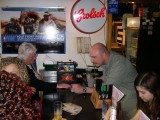 Joanie giving the bartender her last card