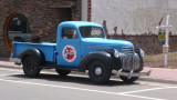 This classic pickup truck parked nearby advertises the Red Garter Inn.