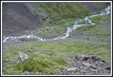Outflow of Flute Glacier-note small human below.