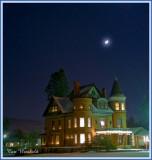 Lewis mansion under moon