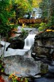 Distant Walking Bridge Over Falls