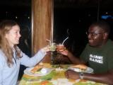 On their honeymoon, London couple Larraine and Tunu make a toast.