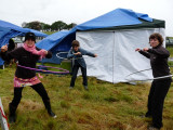 The rain stopped for a moment to let Henri, Kate and Jill show off their hula hoop skills.