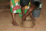 Pottery village Sé. No potter´s wheel to facilitate the work. The woman is turning round and round her pot.