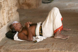 A priest sleeping in the Ranganatha temple in Srirangam, Tamil Nadu.