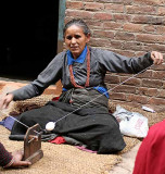 Lady spinning wool in Bhaktapur, Nepal.