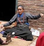 Lady spinning wool in Bhaktapur, Nepal.