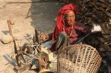 Lady spinning wool in Ghale Gaun, Nepal.