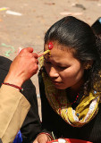Getting a blessing at Dakshinkali temple, Nepal.