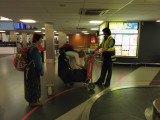 Sherri getting her packages from the recovered luggage