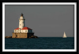 Sailboat and Harbor Lighthouse